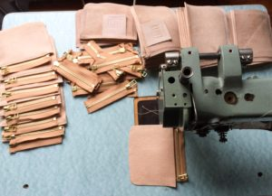 Sewing leather pieces together with zippers