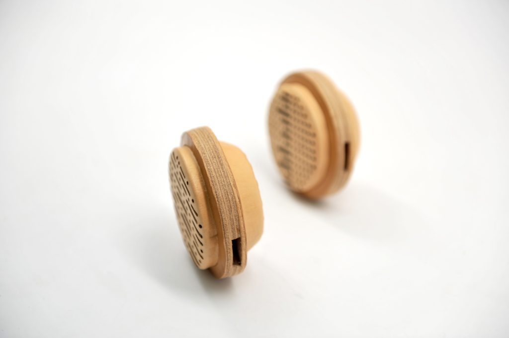 leather goods_wooden headphones covered with leather by Whitney Bai
